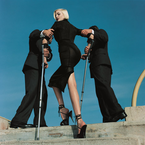 High & Mighty shoot, American Vogue , February 1995, (model: Nadja Auermann) Dolce & Gabbana suit, Summer 1995 © Estate of Helmut Newton / Maconochie Photography