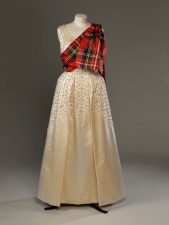 Norman Hartnell, Evening dress of embroidered duchesse satin worn by The Queen with a sash of Royal Stewart tartan for the Gillies Ball at Balmoral Castle in 1971. ROYAL COLLECTION TRUST/ (c)HER MAJESTY QUEEN ELIZABETH II 2016