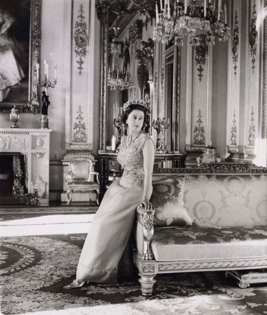 Queen Elizabeth II standing in the White Drawing Room, Buckingham Palace. Official portrait by Cecil Beaton, 1968 'Fashioning a Reign: 90 Years of Style from The Queen's Wardrobe' at the Summer Opening of Buckingham Palace, 23 July - 2 October 2016. Royal Collection Trust / (C) Her Majesty Queen Elizabeth II 2016.