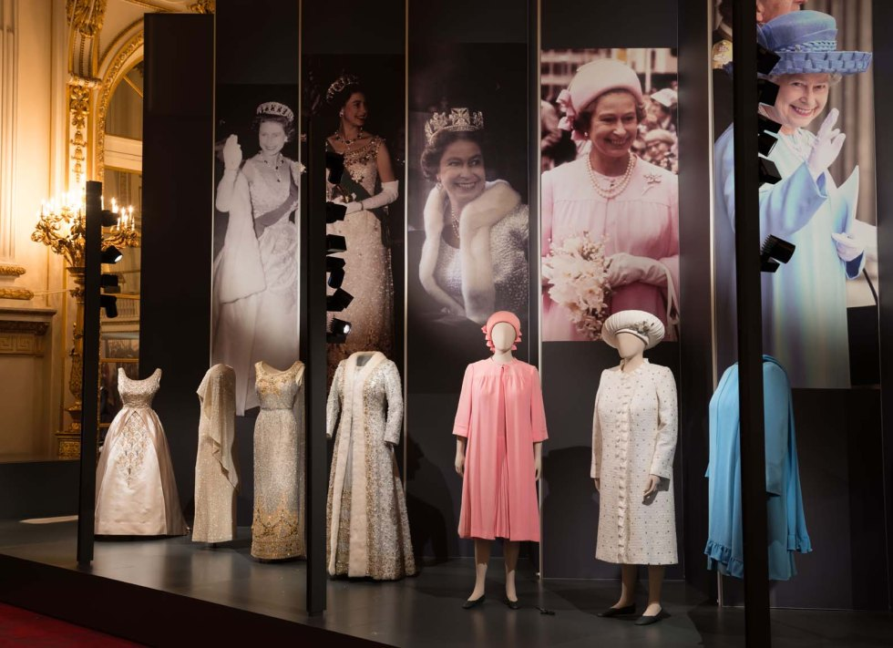 A display of dresses from Fashioning a Reign: 90 Years of Style from The Queen's Wardrobe on display at Buckingham Palace.   Fashioning a Reign: 90 Years of Style from The Queen's Wardrobe at the Summer Opening of Buckingham Palace, 23 July - 2 October 2016. Images must not be archived or sold-on.   Royal Collection Trust / © Her Majesty Queen Elizabeth II 2016.