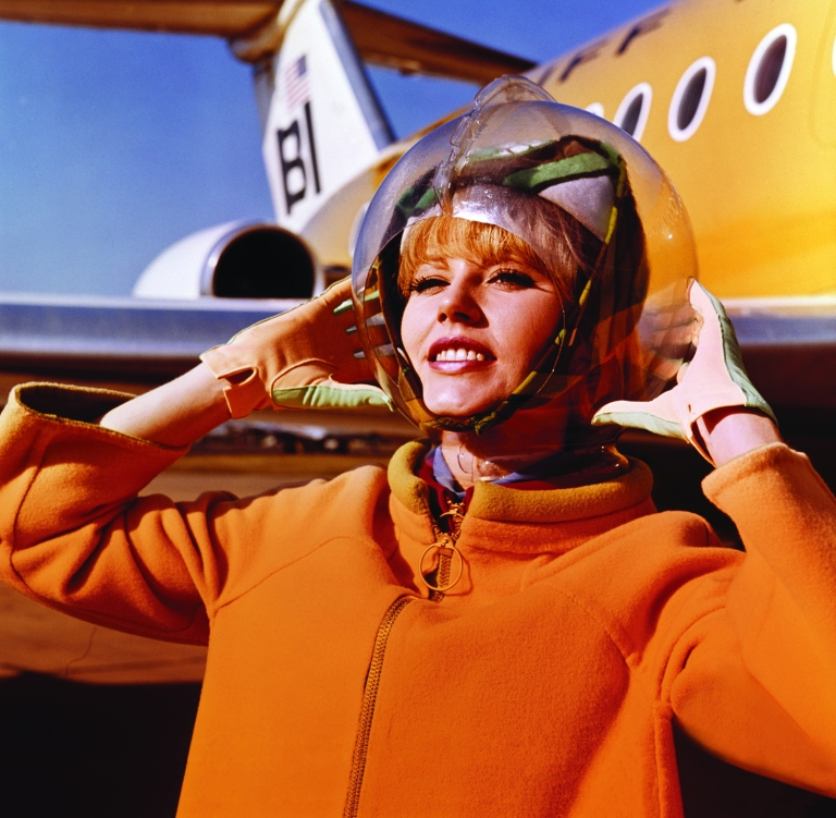 Braniff International Airways hostess in uniform by Emilio Pucci 1965 Photo credit: Braniff International Public Relations Archives, History of Aviation Collection, UT-Dallas