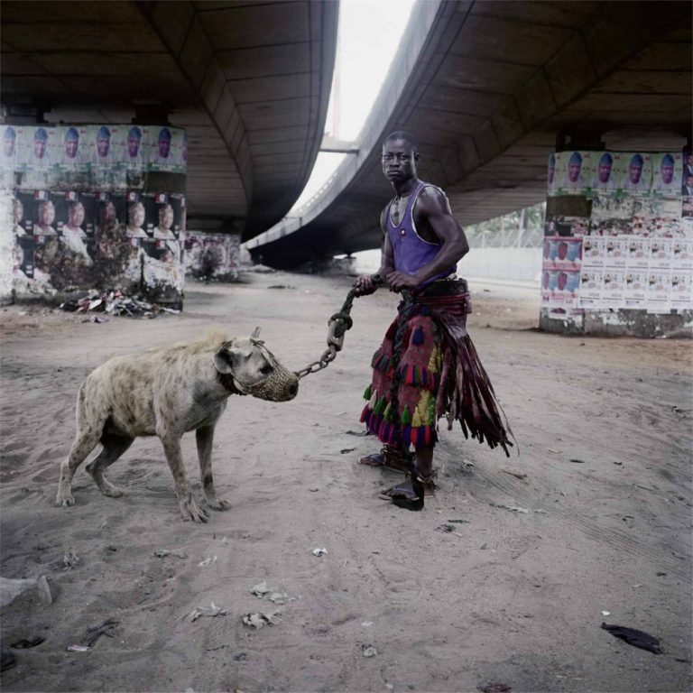 ABDULLAHI MOHAMMED WITH MAINASARA, LAGOS, NIGERIA, FROM THE SERIES 'GADADWAN KURA' - THE HYENA MEN SERIES II, 2005-2007, 2007 c-print © Pieter Hugo, Priska Pasquer, Cologne